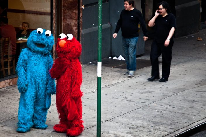 Tickle me for a cookie, Elmo and Cookiemonster on Time Square NYC. Street Photography by Victor Borst