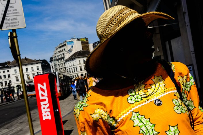 Colorful Portrait at Brussels of an African woman. Street photography by Victor Borst