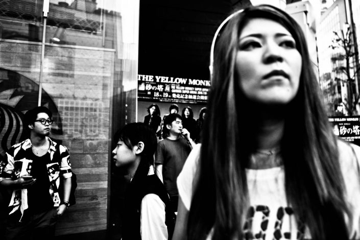 Japanese people at Shibuya looking at different direction at Starbuck. Street Photography by Victor Borst