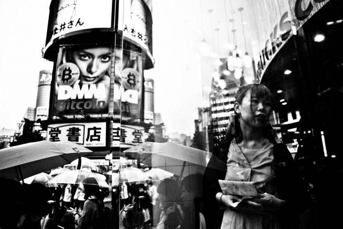 Japanese woman through the windows of Star Bucks at Shibuya, Tokyo. Street Photography by Victor Borst