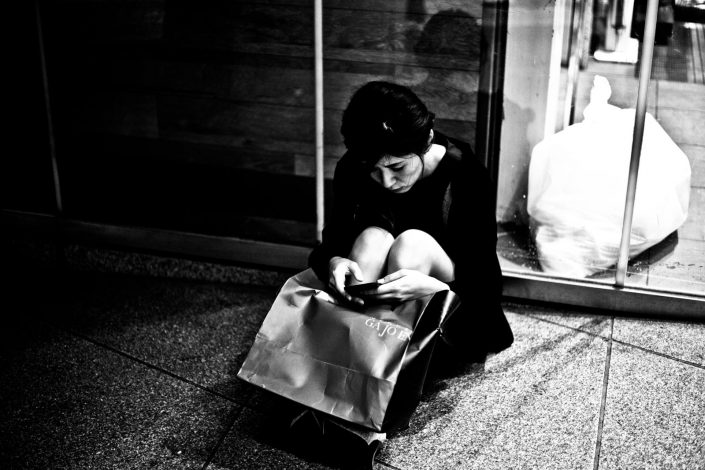 Woman sitting after a long day shopping at Shibuya