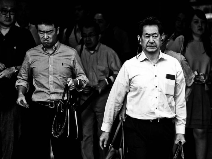 Dirty looking man and one with headphones at Shimbashi station. Street Photography by Victor Borst