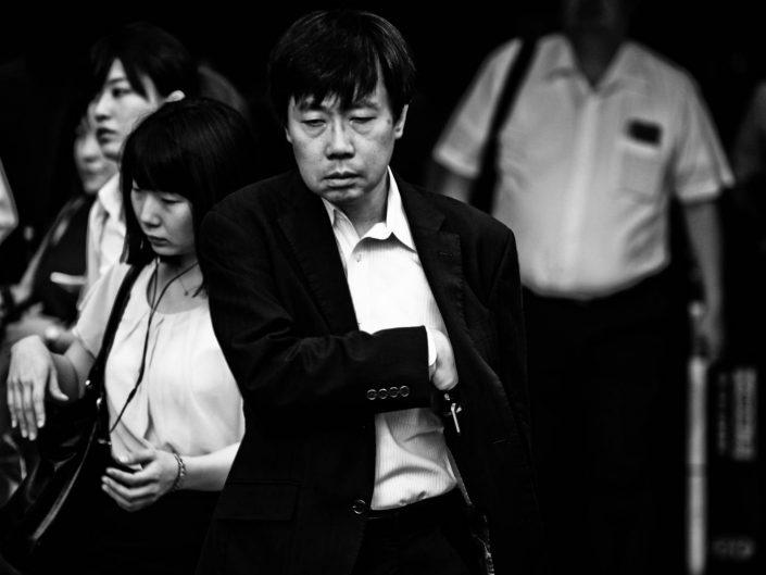 Salaryman at Shimbashi station. A not so happy portrait. Street Photography by Victor Borst