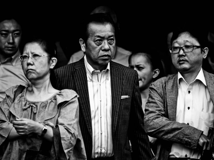 Some salarymen and women at Shimbashi station at another working day. Street Photography by Victor Borst