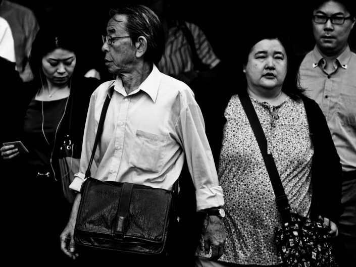 Some salarymen and women at Shimbashi station going to work. Street Photography by Victor Borst
