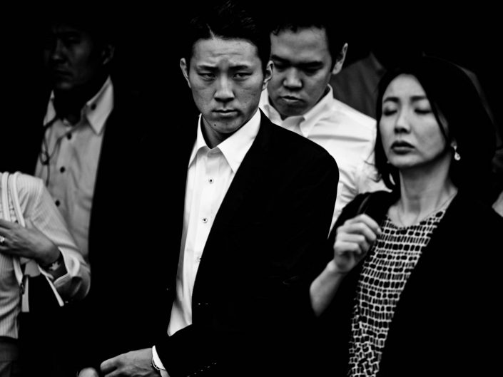A few salarymen and women at Shimbashi station going to work. Street Photography by Victor Borst