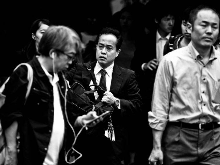 Group of salarymen exiting Shimbashi Station, Tokyo. Street Photography by Victor Borst