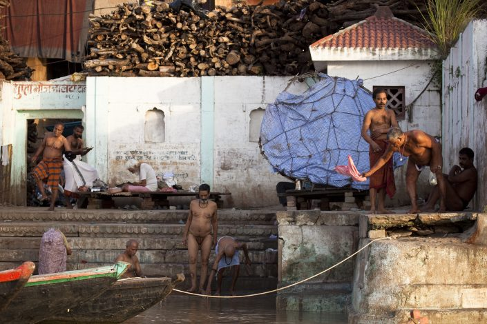Colorful India, man bathing on the banks of the Ganga river in Varanasi